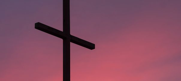 Cross against a sunset